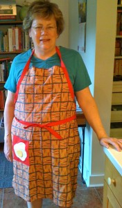 modeling my new apron in bacon-print fabric